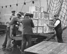 men on a ship, handling crates