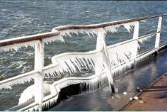 ice frozen onto the railings of a ship